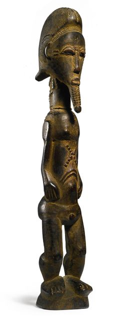 Africa | Male figure from the Baule people of the Ivory Coast | Wood and fiber | ca. early 1900s