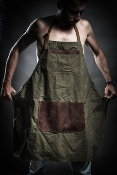 This apron is made of tenting waxed canvas. Good washable with soap and water. Two slip leather pockets. Pockets for pencils and cell phone. Adjustable belts can fit in width and height. PRODUCT DETAILS: - soviet army tenting waxed soft canvas dated back to the 1970s - high quality cowhide cognac brown leather - Upcycled soviet army fabric belts dated back to the 1970s One size. Adult unisex Measurements: Length: 89 cm / 35 inches Width: 76 cm / 30 inches Width at the top of the...