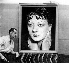 Man Ray sits by a portrait of his lost muse Kiki de Montparnasse, Paris, 1954