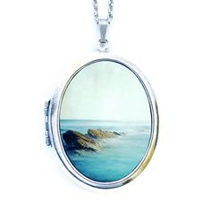 so cool! this photo is on the outside of the locket   Be Here Now Locket Necklace