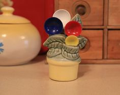Vintage ceramic measuring spoon holder wall pocket -1930s-40s with plastic spoons - cute - great condition