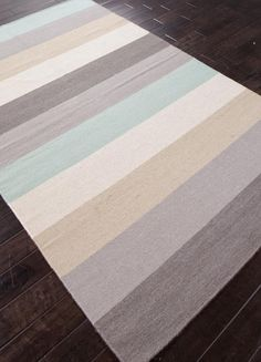 Wide stripes of grey, ivory, sandy beige and aqua make up with 100% wool flat weave area rug.