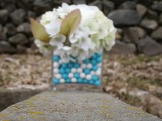A classy twist on a wedding centerpiece for an avid paintballer. Instead of pebbles, fill the bottoms of your centerpieces with paintballs the color of your wedding. LOVE this idea!