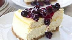 A simple and decadent lemon cheesecake with a fresh blueberry sauce.