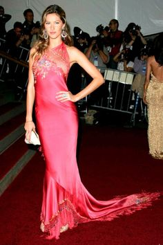 Gisele Bundchen -  In a sea of pale shades and metallics, Gisele added a splash of colour to the 2006 proceedings in a fuchsia Christian Dior gown with embroidered detailing. (2006)