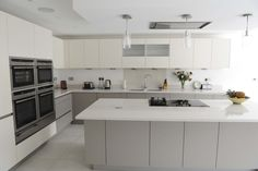 Handleless Kitchen - Nolte Wood Pore Lava and Touch Magnolia with 30mm Silestone worktops in Blanco Norte Quartz