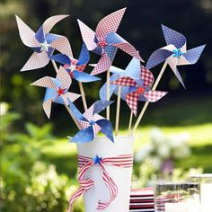 For safer~than~sparklers favors, fill a pail full of festive DIY scrapbook paper pinwheels mounted on slim wooden dowels!  Darling for a tab...