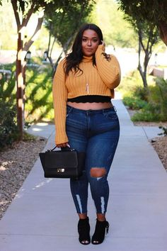 Plus size fall fashion look. Cropped sweater and distressed jeans.