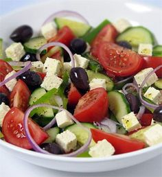 What else says 'summer' like a cool, refreshing Greek salad? Tomatoes, cucumbers and feta cheese combine for a timeless Greek classic. Find traditional and new takes on Greek salad recipes here. Greek Salad Recipes, Salad Recipes No Lettuce, Good Food, Yummy Food, Cooking Recipes, Healthy Recipes, Diabetic Recipes, Healthy Salads, Vegetarian Recipes