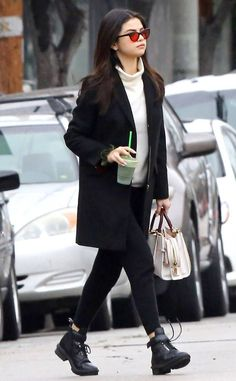 The singer is spotted with juice in tow after a relaxing spa day in West Hollywood with her Coach bag in tow.