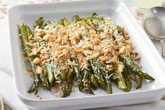 Add instant elegance to your party with this platter of fresh asparagus spears in a delicious cheese sauce and crumb topping.
