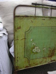 Beautiful metal bed with original looking green paint. There's nothing like old green paint.
