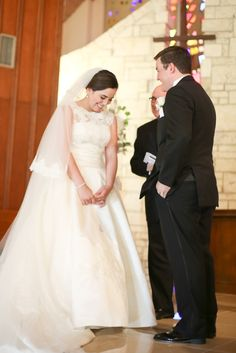bride and groom exchanging vows at ceremony.  read our vows on the blog.