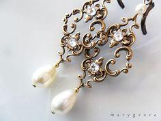 Swarovski crystal Rhinestones on antique gold art nouveau / rococo style filigree's. Swarovskis pearls.