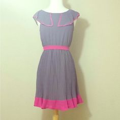 $12 SALE Perfect Day Dress NWT What a beautiful dress to wear for summer. Excelling new condition with tag. Material is 100% polyester & lining is also 100% polyester. Measures from armpit to bottom hem 26 inches long. Measures 15 inches across chest. It has this pink wrap around belt that comes with it. Back zipper. Color is like gray/violet/purple that's hard for me to describe. The pink detail makes the dress pops up. Please no trading or pp. Esley Dresses
