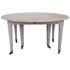 19th Century French Drop Leaf Extension Dining Table   From a unique collection of antique and modern dining room tables at http://www.1stdibs.com/furniture/tables/dining-room-tables/