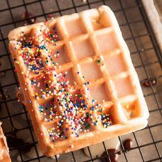 Homemade Wonuts (Waffle Donuts) with a sugary vanilla glaze and a chocolate glaze with rainbow sprinkles