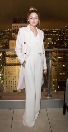 Olivia Palermo in a white jumpsuit and blush topper.