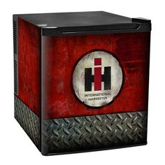 Fridge is decorated with a distressed International Harvester diamond plate design. International Tractors, International Scout, International Harvester, Farmall Tractors, John Deere Tractors, Red Tractor, Tractor Seats, Tractor Pulling, Garage Art