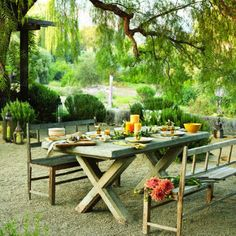 "Outside dining!! Tuscan dining: The courtyard    Designer Paul Hendershot calls his Ojai, Calif. garden ""a Mediterranean courtyard without walls.""    The centerpiece is a concrete-topped table (more on that next slide)."
