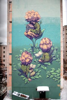 """Russian street artist Rustam Qbic just completed a new 9-story mural in Nizhny Novgorod, Russia for the New City festival. Titled """"Blossom"""" the mural depicts individuals whose heads are literally """"blooming"""" while reading books, an irony not lost on the artist who worked through 11 days of frigid cold and snow to complete the work."""