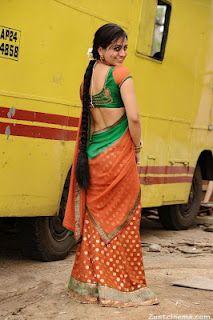 Aksha Naughty Stills in Spicy Green Choli Backless Beauty half Saree