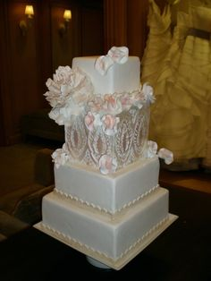 4 tier cake white, pink and gold!  One of our favorites!