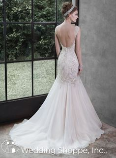 A glamorous beaded fit and flare with stunning low back | Maggie Sottero  Bridal Gown Melissa