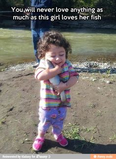 Too cute! She really loves that fish
