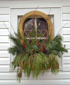 Winter window box- stuff with greens, berries and branches for a festive look outside.
