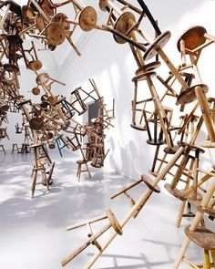 ai weiwei's #installation* 'bang' used 886-three legged wooden stools were installed in an expansive rhizomatic structure inside the german pavilion.  see more work by #aiweiwei on #designboom! @aiww image by #romanmensing . . * at the 2013 venice art biennale