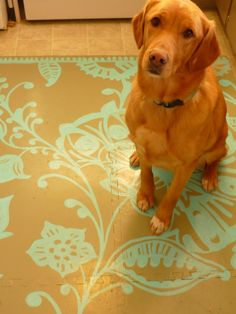 Kids foam floor mat + paint = Hello, new kitchen floor mat.  Cheap, customizable, washable!  Lucy, you have a clever mom!