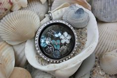 Origami Owl Beach Locket  For questions, please email betsyowl1@gmail.com  To place an order, visit my website directly at betsyowl1.origamiowl.com
