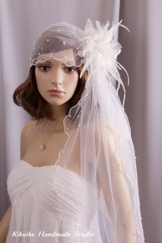 Bridal  veil --- French and  Vintage style,lace bridal cap with tulle, feather,silk flower and pearls. $180.00, via Etsy.