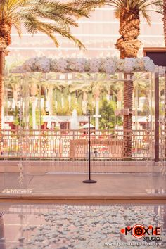 Acrylic Chuppa with a crystal backdrop and all white floral. Wedding Planned & Designed by Weddings By Dzign. Floral and Décor by Weddings By Dzign Las Vegas Photography: Moxie Studio Photography & Cinema. Venue: Red Rock Resort & Casino Las Vegas