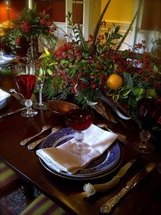 winter tablescape: greens/fruit/feathers