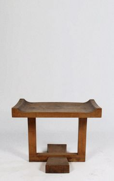 sold by Live Auctioneers. mid century modern wood bench having saddle seat and simple elegant base circa 1970