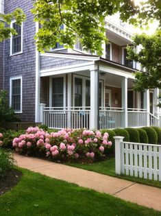 cute house and beautifully landscaped front yard. I love white trim..