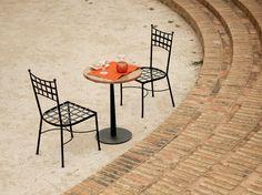Terreaza cafeteria. Silla de forja modelo Pisa. www.fustaiferro.com
