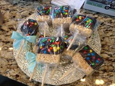 Chocolate covered rice crispy treat with mini chocolate candies.