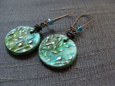 Handcrafted polymer clay floral charms offer a delicate wisp of willows and wildflowers in this popular bright teal color. Instantly add a little cheer to your day when you wear these out and about. The earrings are lightweight and great for everyday wear. The handcrafted charms started as a sketch, I then carved the designs and created the charms. Each charm has been hand painted, antiqued and distressed for a worn and loved look. A tiny faceted glass bead adds just a touch of sparkle.