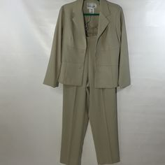 Just a nice little lightweight summer suit Very beautiful color good condition lightweight the color is probably not showing up it's an olive green light olive green Dani max Other