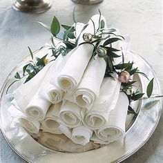 Instead of flat-stacking linen napkins for your buffet guests, make a pyramid of individually rolled napkins, each ringed with greenery fastened to a mini Christmas ball or jingle bell with florist's wire.