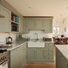 Sage Green Kitchen Cabinets Renovated Schoolhouse To Family House Mobile Homes Can Be Cool Sage Green Kitchen, Green Kitchen Cabinets, Kitchen Cabinet Colors, Painting Kitchen Cabinets, Kitchen Paint, Kitchen Redo, Kitchen Colors, Kitchen Ideas, Kitchen Units