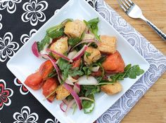Panzanella Salad with Arugula--Made with tomatoes, onions, and other vegetables, this recipe is awesome if you're looking for a salad with arugula, a spicy green that adds a punch of flavor. #panzanella #salad #arugula
