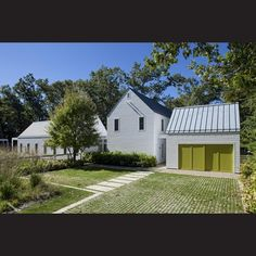 The garage volume, which incorporates a self-contained apartment on the upper level, has barn-style doors.