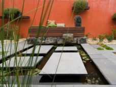 We have utilised Bluestone Pavers as regular shaped stepping stones and around the edge of this pond in Armadale