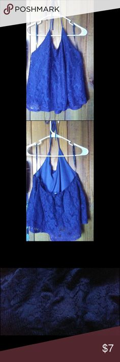 Size Medium . Sleeveless shirt , ties around neck Size Medium . Super cute dark blue sleeveless shirt , ties around your neck . has flowery designs also . it looks light blue in the pic but its not . in the 3rd pic i put the color it really is . Good condition Tops Blouses