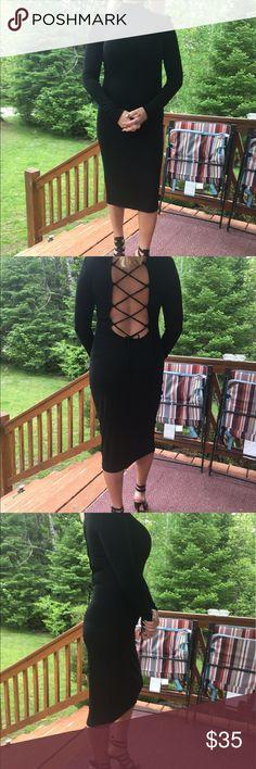 Victoria's Secret black dress Victoria's Secret Moda International black long sleeve dress with criss cross back and mock turtleneck. Victoria's Secret Dresses Long Sleeve