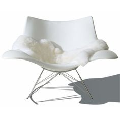 Stingray was designed by Thomas Pedersen in 2002 as a modern interpretation of the classic rocking chair. Pedersen is often inspired by organic shapes found in nature, and found the flowing shape of the stingray fish the perfect muse for the shape and nam House Color Schemes, House Colors, Colour Schemes, Bedroom Furniture, Home Furniture, Sitting Positions, Take A Seat, Japanese Design, Club Chairs